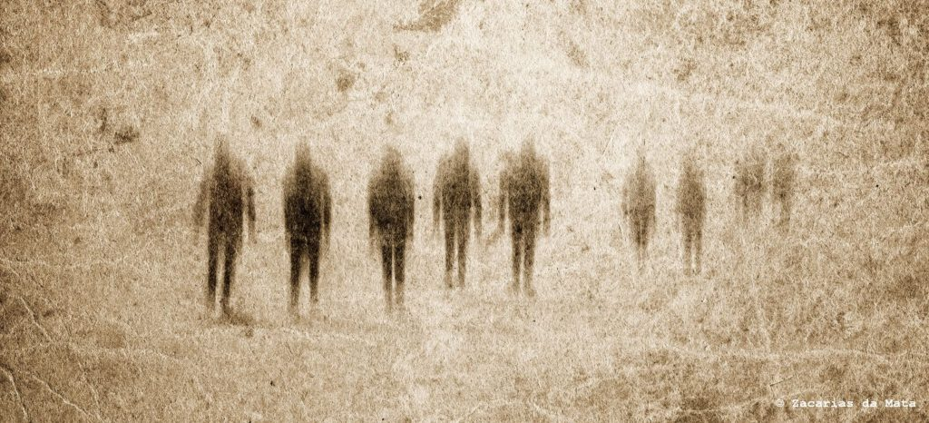 Very old grunge paper background with zombies or ghosts.