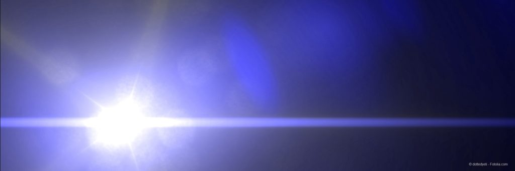 banner with a bright sun, light rays and lens flare in a dark blue sky
