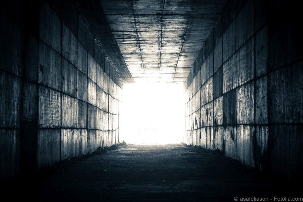 concept - light at the end of the tunnel