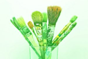Old paint brushes in a glass